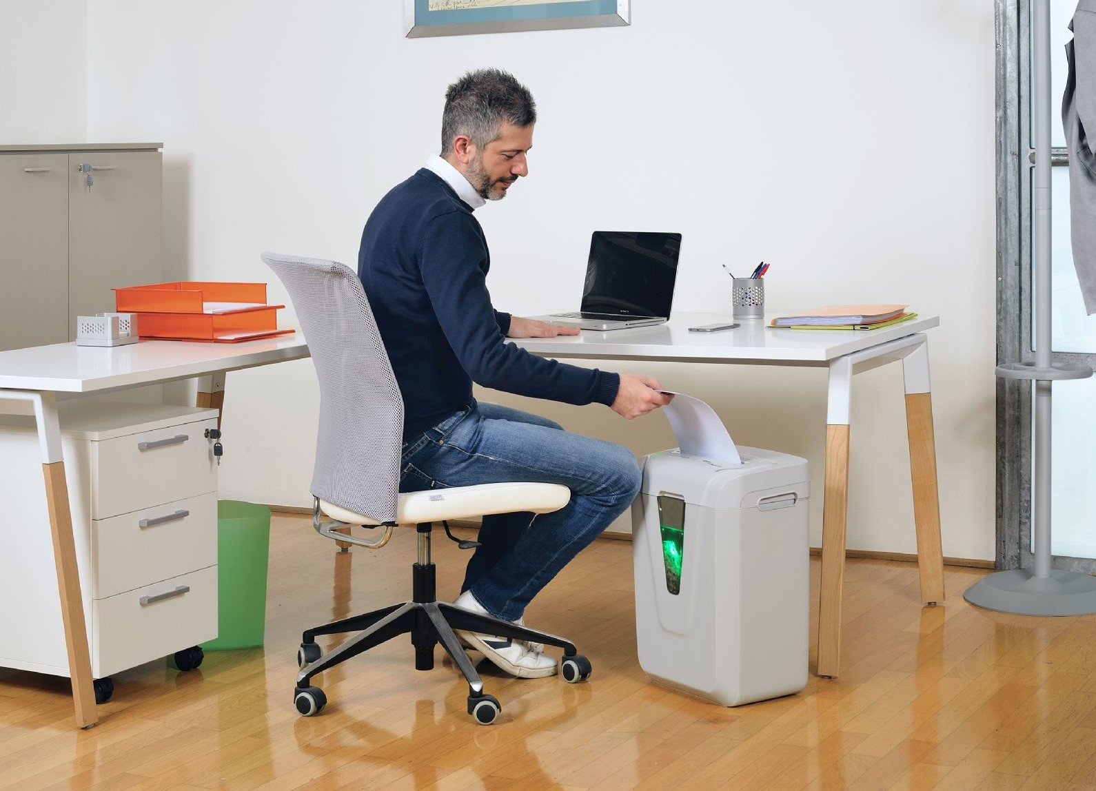 Person uses shredder in their office